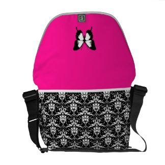 Negro y blanco y rosado con las alas bolsa de mensajería