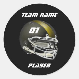Negro y casco de fútbol americano del oro pegatina redonda
