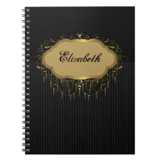 Negro y cuaderno adornado de la raya del oro