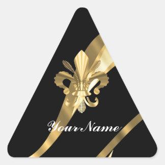 Negro y flor de lis del oro pegatina triangular