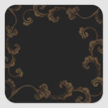 Negro y hojas adornadas del oro etiqueta
