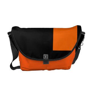 Negro y mandarina bolsas de mensajería