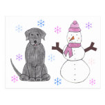 Negro y muñeco de nieve del labrador retriever postal