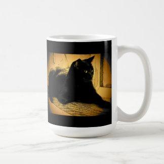Negro y naranja taza de café