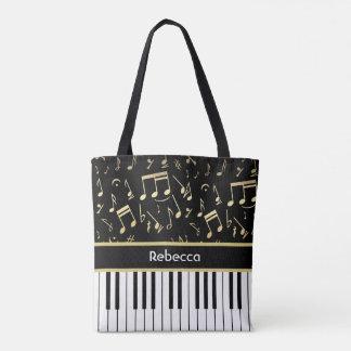 Negro y oro de las notas musicales y de las llaves bolsa de tela