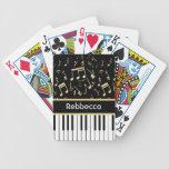 Negro y oro de las notas musicales y de las llaves cartas de juego