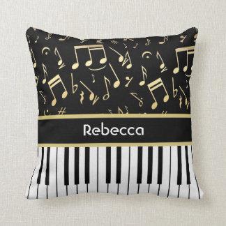 Negro y oro de las notas musicales y de las llaves cojín decorativo