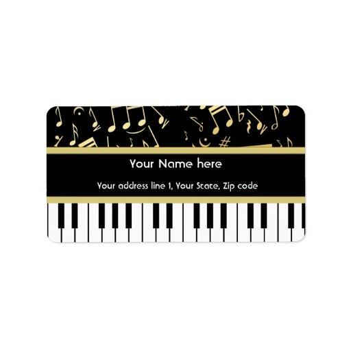Negro y oro de las notas musicales y de las llaves etiquetas de dirección