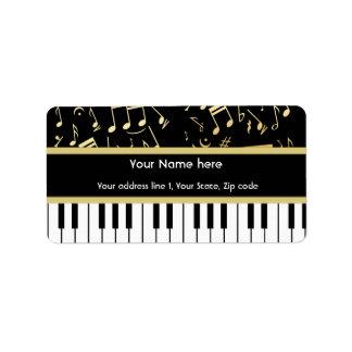 Negro y oro de las notas musicales y de las llaves etiqueta de dirección