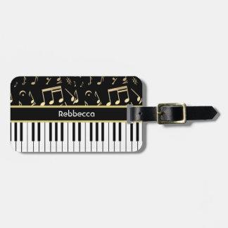 Negro y oro de las notas musicales y de las llaves etiquetas maletas