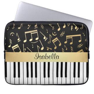 Negro y oro de las notas musicales y de las llaves funda ordendadores