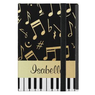 Negro y oro de las notas musicales y de las llaves iPad mini coberturas