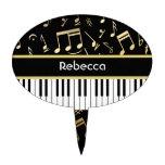 Negro y oro de las notas musicales y de las llaves palillos de tarta
