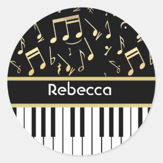 Negro y oro de las notas musicales y de las llaves pegatina redonda
