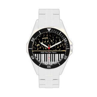 Negro y oro de las notas musicales y de las llaves relojes de pulsera