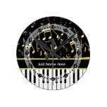 Negro y oro de las notas musicales y de las llaves reloj redondo mediano