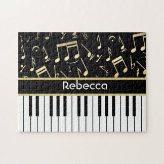 Negro y oro de las notas musicales y de las llaves rompecabezas