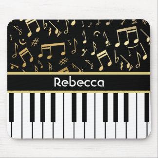 Negro y oro de las notas musicales y de las llaves alfombrilla de ratón