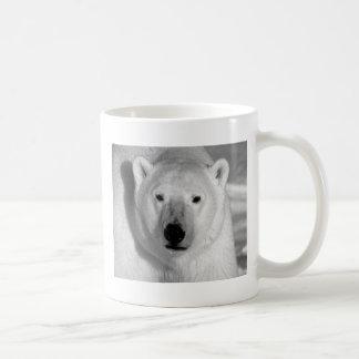 Negro y oso polar de la pizca taza de café