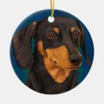 Negro y retrato del Dachshund del oro en azul Ornamento Para Arbol De Navidad