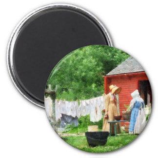 Neighbors Gossiping on Washday Magnets