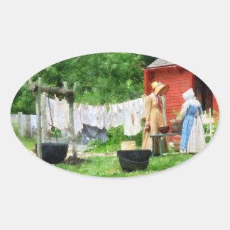 Neighbors Gossiping on Washday Oval Stickers