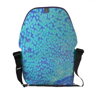 Neon coral messenger in blue commuter bag