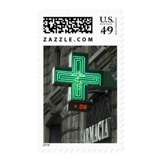 Neon Green cross outside Farmacia (Drug store or Postage