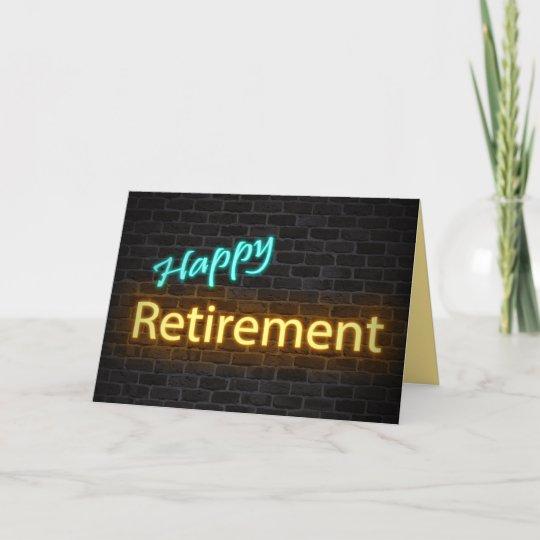 neon happy retirement sign on brick card