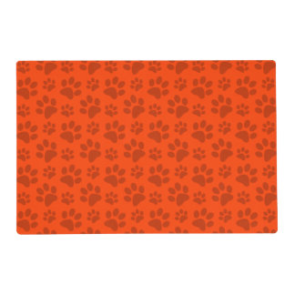 Neon orange dog paw print placemat
