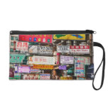 Neon signs in the streets of Hong Kong Wristlet Clutch
