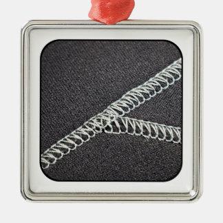 Neoprene seam metal ornament