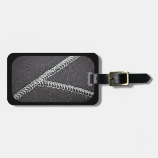 Neoprene seam tag for luggage