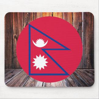 Nepal flag circle on wood background mouse pad