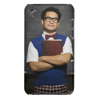Nerdy Asian male student holding school book iPod Touch Cover