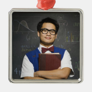 Nerdy Asian male student holding school book Metal Ornament
