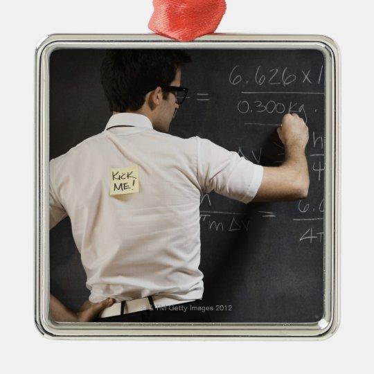 Nerdy man writing on blackboard metal ornament