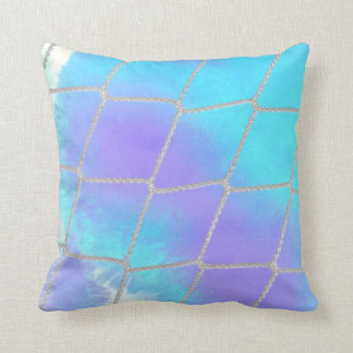 Net background with light blue throw pillow