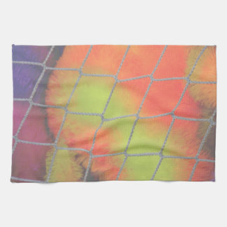 Net background with orange and yellow furry image towel