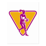 netball player catching passing ball post card