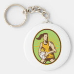 Netball player passing the ball woodcut key chains