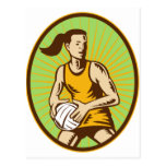 Netball player passing the ball woodcut postcard