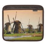 Netherlands, Kinderdijk. Windmills next to iPad Sleeve
