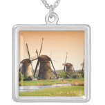 Netherlands, Kinderdijk. Windmills next to Pendant