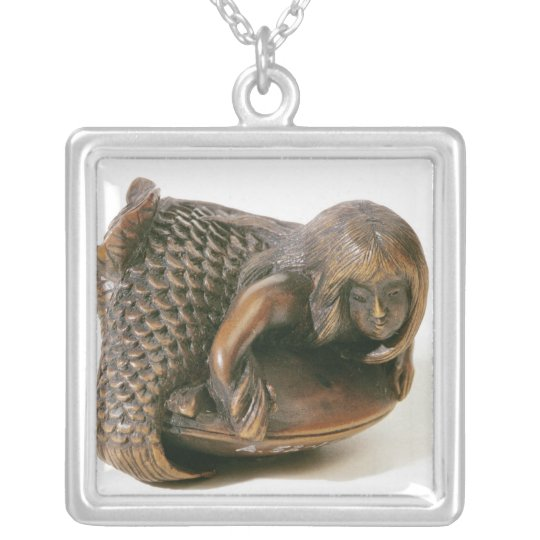 Netsuke carved in the shape of a mermaid silver plated necklace