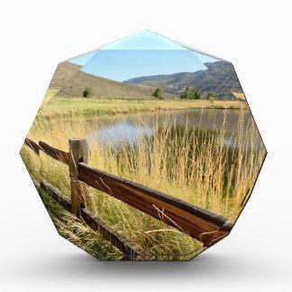 Nevada landscape with wood fence, lake, sky. award