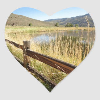 Nevada landscape with wood fence, lake, sky. heart sticker