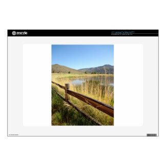 Nevada landscape with wood fence, lake, sky. laptop decal
