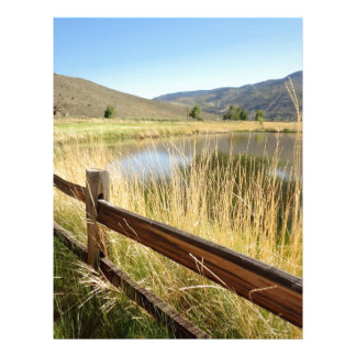 Nevada landscape with wood fence, lake, sky. letterhead