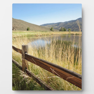 Nevada landscape with wood fence, lake, sky. plaque